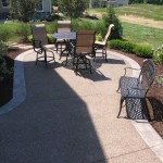 PATIO: EXPOSED AGGREGATE<br /> BORDER PATTERN: 5×5 SLATE SKIN<br /> COLOR HARDENER: SUN BUFF<br /> RELEASE: DARK WALNUT